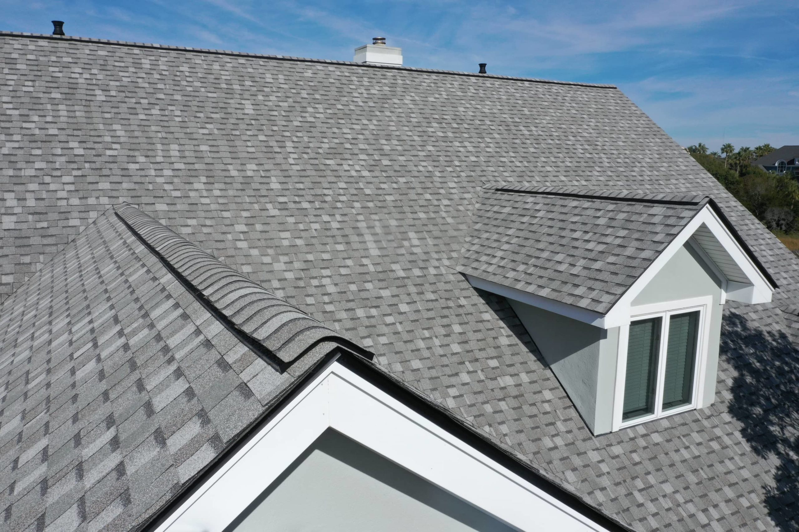 This is an image of a residential property using roof shingles for the roofing.