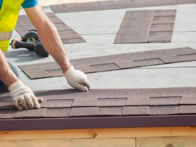 This is an image of a roofing contractor replacing roof shingles.