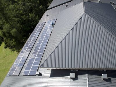 This is an image of a commercial metal roofing with solar panels installed.