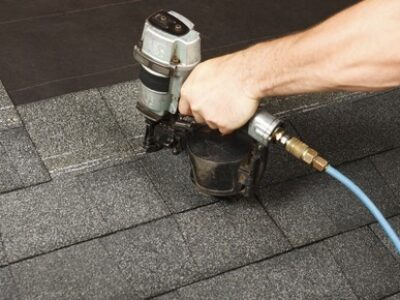 This is an image of a contractor repairing roof and installing new roof shingles.